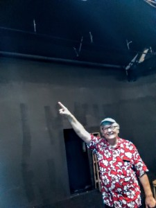 Ray Tatar inspects renovations in the California Stage Theater